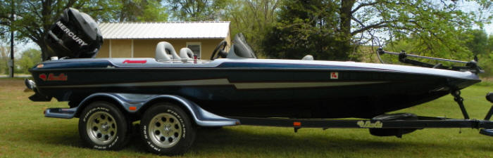 "a fully equipped Bass Cat ""Puma"" Boat 20'4"" long."